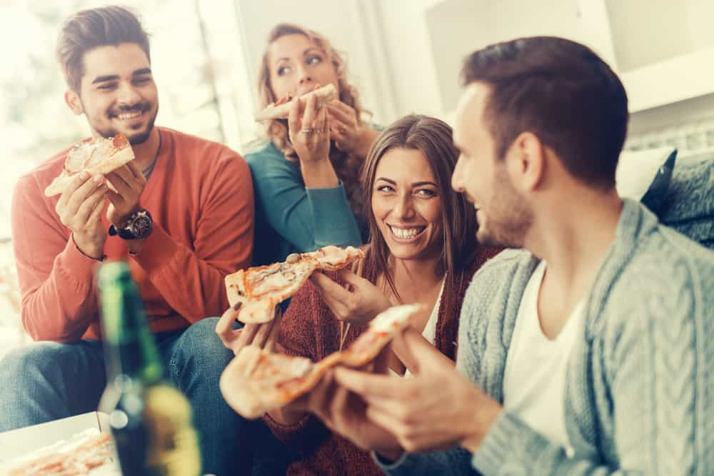 Friends eating pizza and having fun