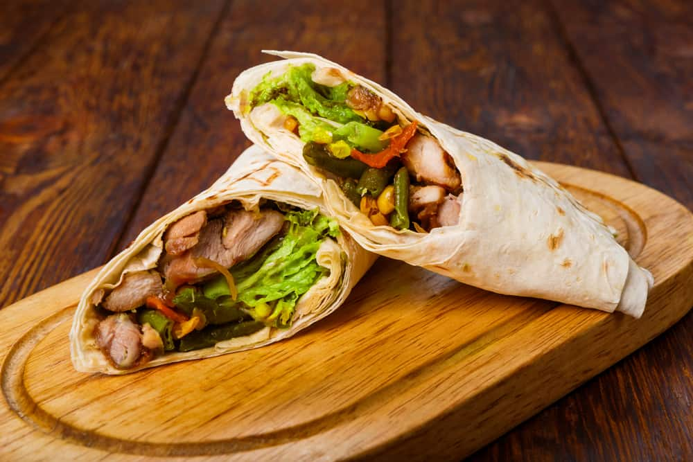 Mexican restaurant fast food - wrapped burritos with chicken and vegetables