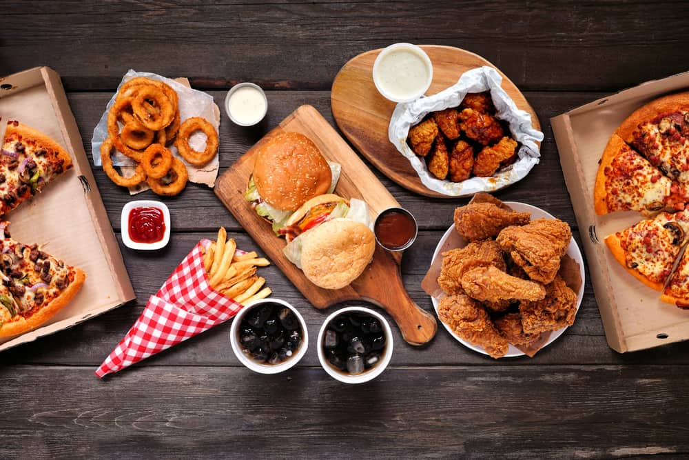 Table scene with large variety of take out and fast foods